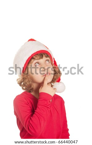 Happy little girl waiting for christmas wearing a santa hat - isolated