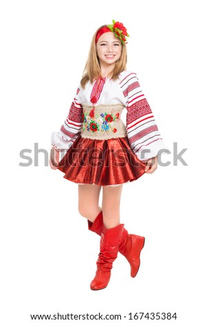 Happy little girl wearing Ukrainian national clothes. Isolated on white - stock photo