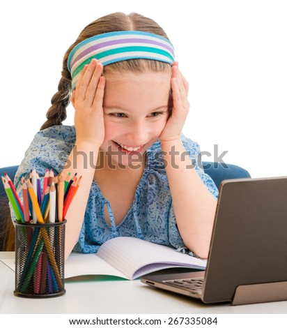 Happy little girl wiht her magic tablet isolated on white - stock photo