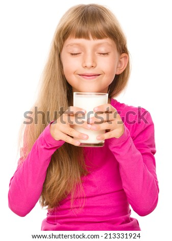 Happy little girl with a glass of milk, isolated over white - stock photo