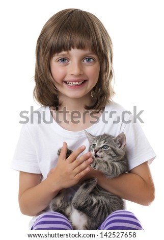 happy little girl with a kitten - stock photo