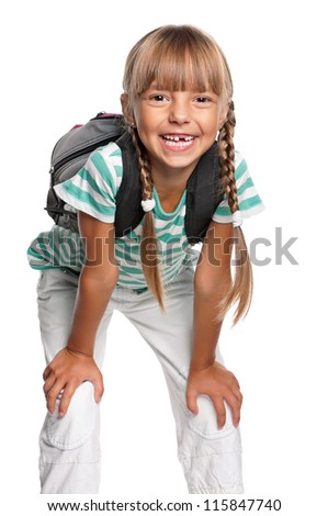 Happy little girl with backpack isolated on white background - stock photo