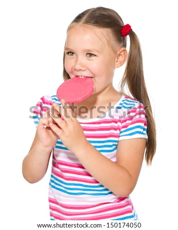Happy little girl with big lollipop, isolated over white - stock photo