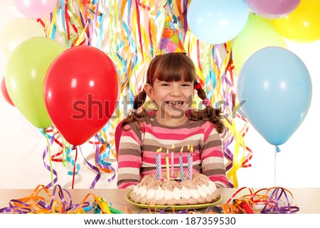 happy little girl with birthday cake - stock photo