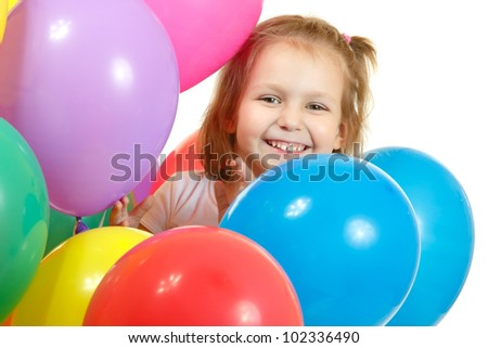 Happy little girl with color balloon isolated on white background