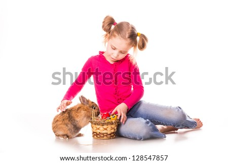 Happy little girl with easter bunny and eggs isolated on white. Happy Easter