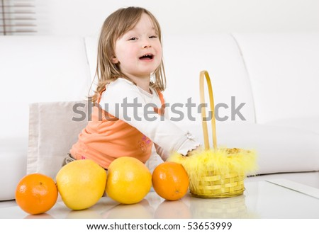 happy little girl with fruits