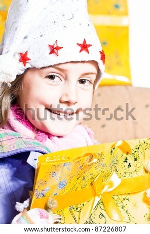 Happy little girl with gifts