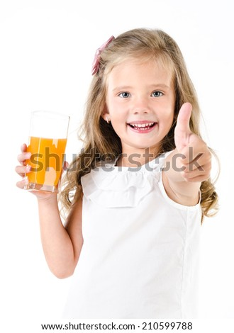 Happy little girl with glass of juice and finger up isolated on a white - stock photo
