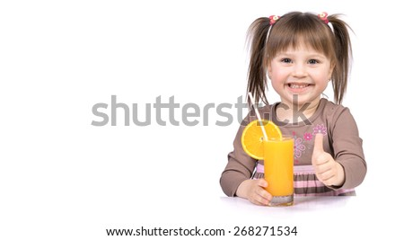 Happy little girl with glass of juice and finger up isolated on a white
