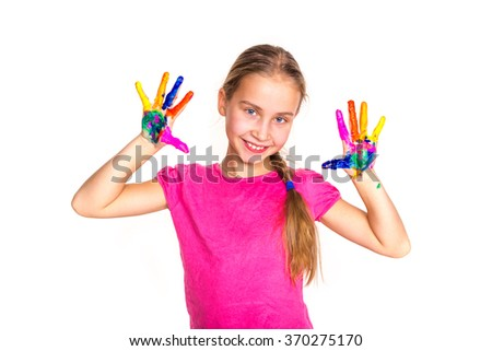 Happy little girl with her hands in paint isolated on white. Art concept - stock photo