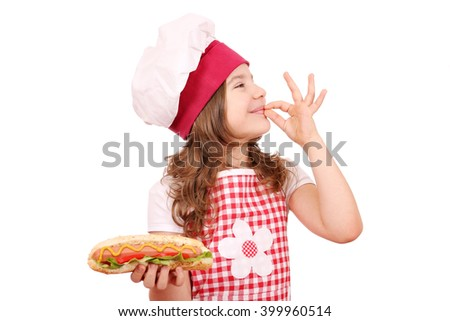 happy little girl with hot dog and ok hand sign