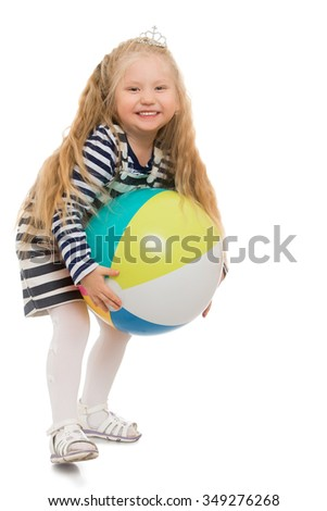 Happy little girl with long flowing blond hair playing with a ball - Isolated on white background.The concept of a Happy childhood and rest - stock photo