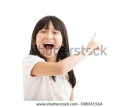 happy little girl with pointing finger - stock photo