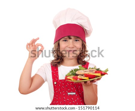 happy little girl with salmon seafood and ok hand sign - stock photo