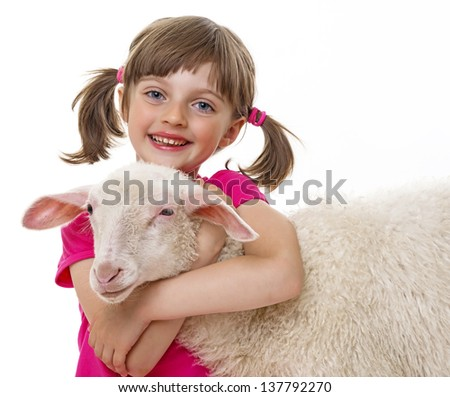 happy little girl with sheep - stock photo