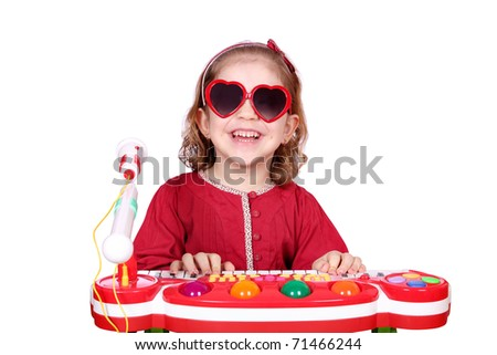 happy little girl with sunglasses play music - stock photo