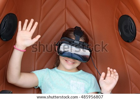 happy little girl with virtual reality headset play video game