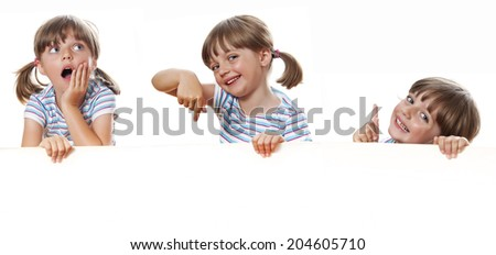 happy little girl with white blank with empty space for text - stock photo