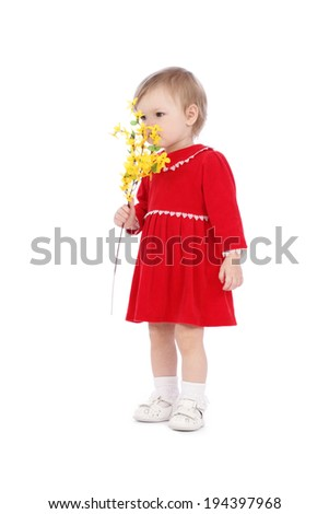 Happy little girl with yellow flower isolated over white background