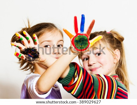 Happy little girls with painted hands