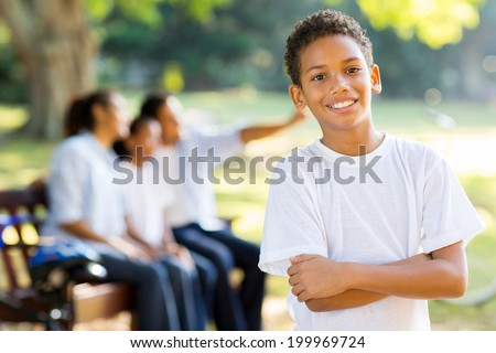 happy little indian boy in front of family outdoors