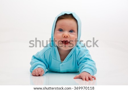 Happy little kid in blue hood - stock photo
