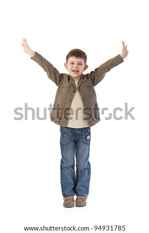 Happy little kid standing with arms wide open, smiling happily.? - stock photo