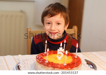 Happy little kid with birthday cake teeth smile
