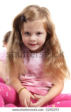 Happy little princess with a beautiful hair. Shot in studio.