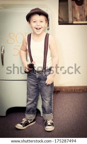 Happy little Rock-a-billy boy with soda - stock photo