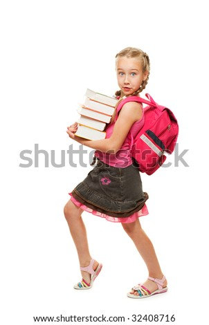 Happy little schoolgirl with a stack of heavy books - stock photo