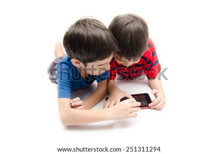 Happy little sibling boy use tablet on white background - stock photo