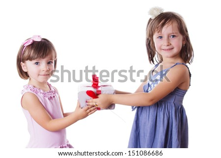 Happy little sisters holding present isolated on white background