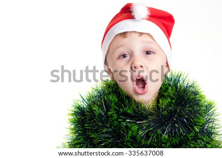 Happy little smiling boy with christmas hat. Concept of happy merry christmas.