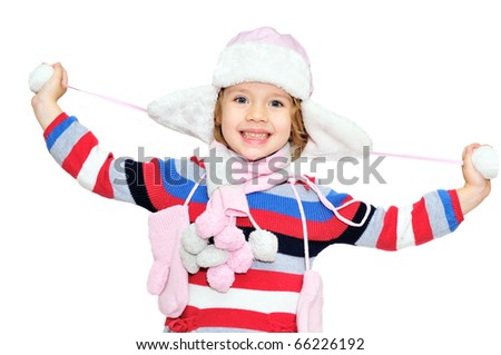 happy little  winter girl wearing hat, srarf and mitts - stock photo