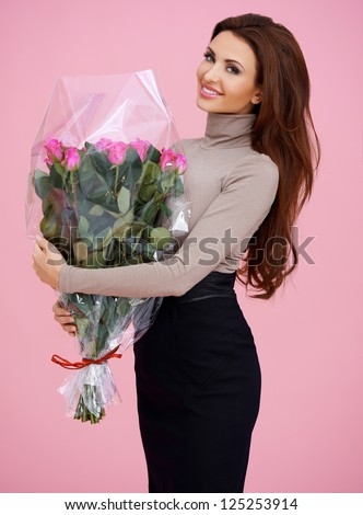http://thumb1.shutterstock.com/display_pic_with_logo/61004/125253914/stock-photo-happy-long-brown-haired-young-woman-holding-holding-a-flowers-bouquet-posing-125253914.jpg