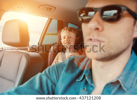 Happy long journey in car with father - stock photo