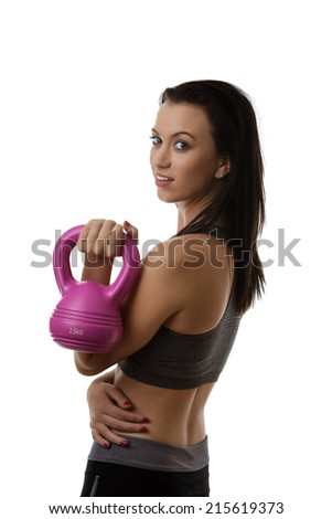 happy looking woman looking at camera doing exercise