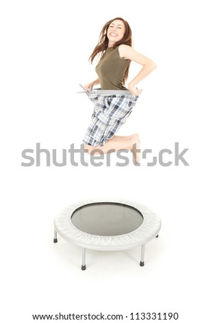 happy losing weight girl jumping, full length, white background - stock photo