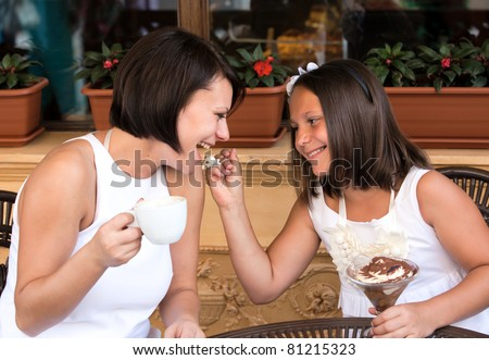 Happy lovely family in cafe - stock photo