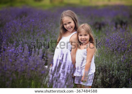 Happy Lovely girl kids on a lavender farm  - stock photo