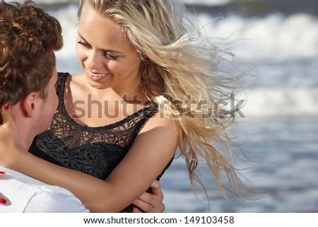 Happy lovers at the beach  - stock photo