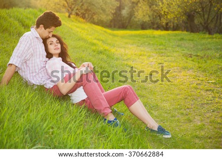 Happy lovers couple. Love story. Spring. Man and woman couple. Sunset, city park, outdoor, summer - happy, love, concept. - stock photo