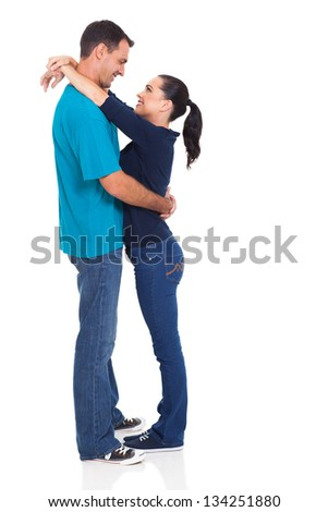 happy loving couple embracing over white background