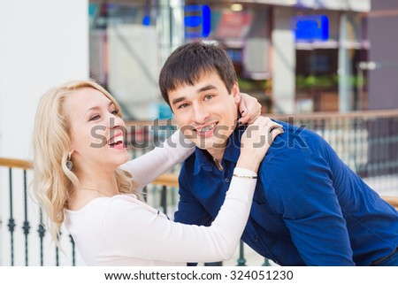 Happy loving couple. Happy young man holding his girlfriend in his arms  - stock photo