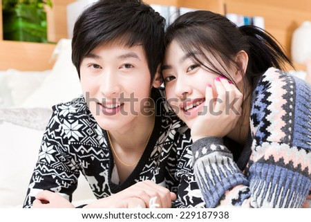 Happy loving couple in a living room. - stock photo