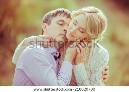 happy loving couple in the summer park  - stock photo