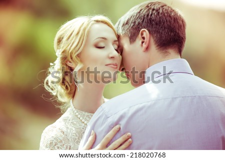 happy loving couple in the summer park (focus on the woman) - stock photo