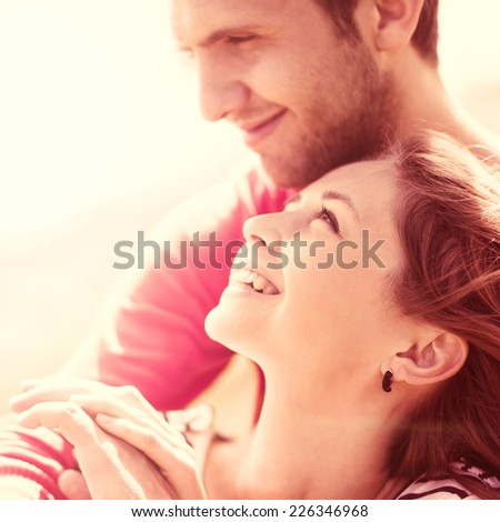 Happy loving couple on a warm sunny summer day - stock photo